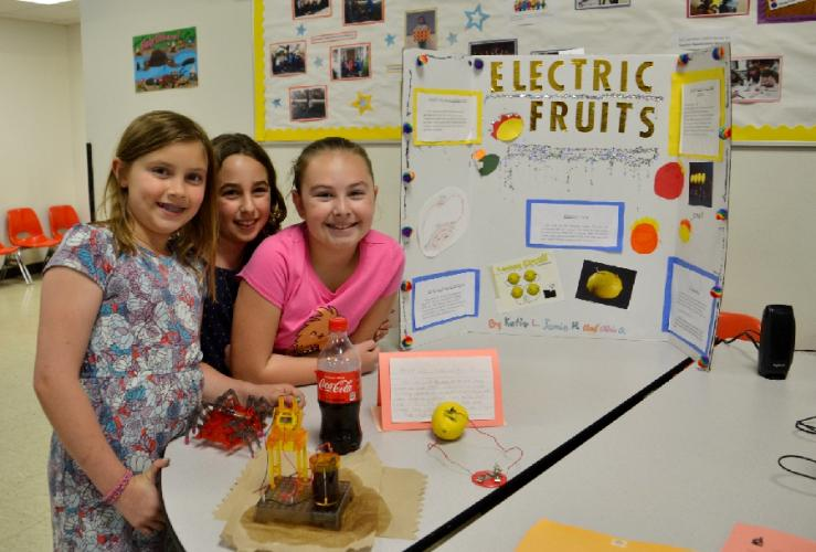 Pictured from left are Jamie Humpreys, Katie Lye, and Olivia Gulao of the group Electric Fruits with their soda powered clock at the Head O' Meadow Science and Health Expo. (Bee Photo, Silber)