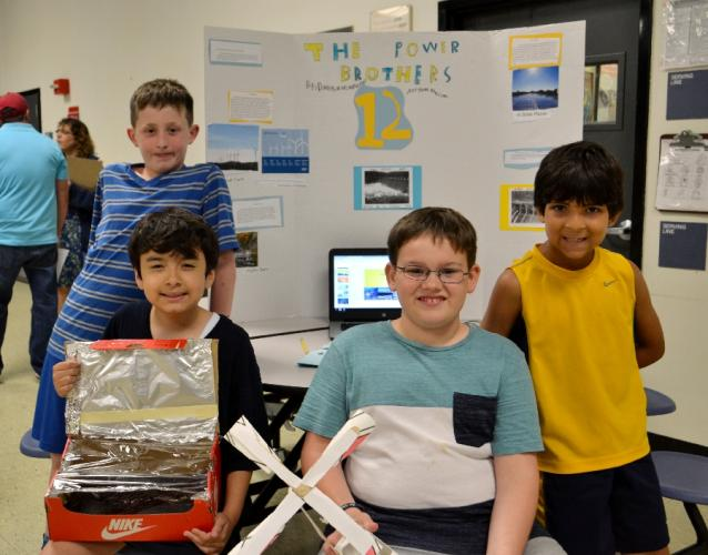 Pictured from left are The Power Brothers members Kori Briganti, Marc Anthony Becerra, Daniel Fonck, and Massimo Ferrone at the Head O' Meadow Science and Health Expo on June 21. (Bee Photo, Silber)