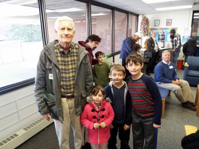 United States Army Veteran Bob Haugeto stood with his grandchildren Claire, Ben, and Andrew Hoyack at Head O' Meadow Elementary School on Friday, November 11.  (Bee Photo, Silber)