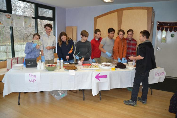 After the Housatonic Valley Waldorf School's Thanksgiving Assembly on November 22, the Class of 2018 served food for guests at the Sweet and Savory Bake Sale. (Bee Photo, Silber)