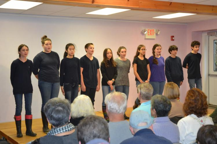 """Seventh grade students at Housatonic Valley Waldorf School performed a folk song from Ghana called """"Tue Tue,"""" as well as a gumboot dance and a recitation of Maya Angelou's poem, """"Africa,"""" at the Thanksgiving Assembly. (Bee Photo, Silber)"""