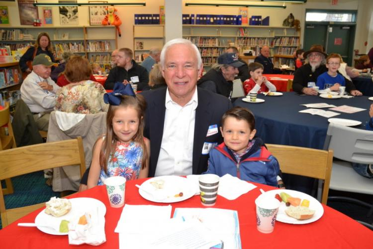 United States Marine Corps veteran Bill Manfredonia enjoyed a special Veterans Day breakfast with his grandchildren Kailyn Lahey, 6, and Cian Lahey, 5, at Hawley School on Friday, November 10. (Bee Photo, Silber)