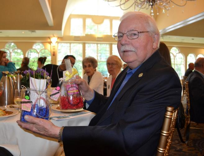 Lee Hossler was the lucky recipient of not one - but two - raffle wins during the Newtown Giving Circle's 29th Annual Summer Breakfast to benefit the Regional Hospice and Palliative Care. (Bee Photo, Silber)