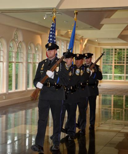 Officer William Chapman led the Newtown Police Department Honor Guard, followed by Officers Matt Hayes, Richard Monckton, and Benjamin Mulhall, at the Newtown Giving Circle's 29th Annual Summer Breakfast on June 13. (Bee Photo, Silber)