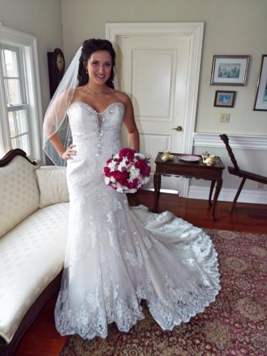 Pictured is model Kathryn Ascenzi posing in an Allure Bridals' fit-and-flare gown during the Julie Allen Bridals photoshoot at The Dana-Holcombe House on October 30. (Bee Photo, Silber)