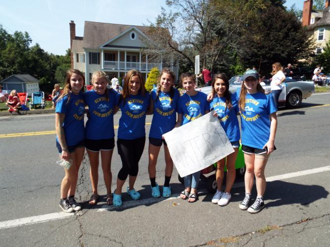 Many local sports teams sold water during the Labor Day Parade to raise money for their groups, including Newtown Swim and Dive. (Bee Photo, Silber)
