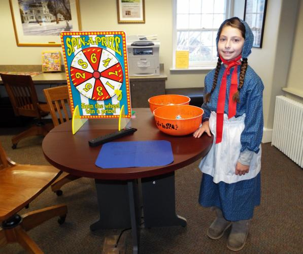 Young Adult Council member Jillian Hoag helped at the Spin-A-Wheel game where children could play to win a variety of prizes. (Bee Photo, Silber)