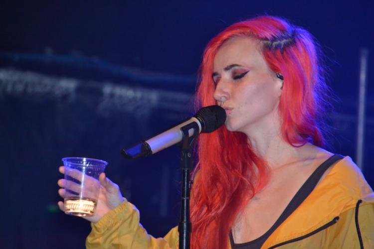 """After a wardrobe change, Lights raised a glass and sang her song """"Muscle Memory"""" from her album """"Little Machines"""" during her set at Irving Plaza on February 26. (Bee Photo Silber)"""