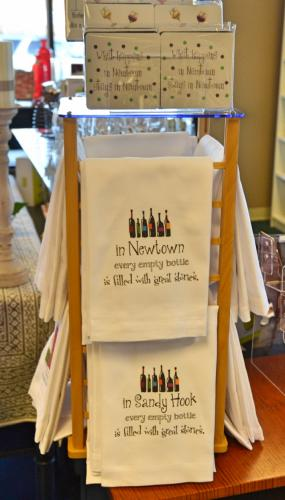 """Those looking for Newtown or Sandy Hook specific items can find products at the Lorraine K. Boutique, like these hand towels that say """"In Newtown every empty bottle is filled with great stories."""" (Bee Photo, Silber)"""