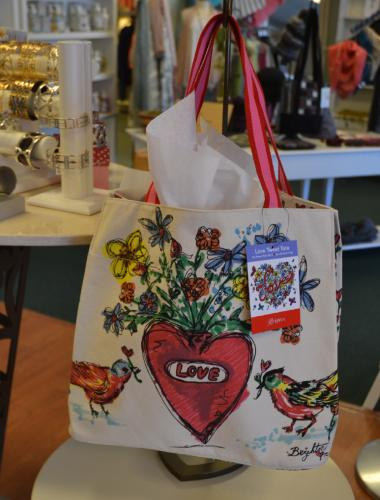 The Lorraine K. Boutique offers a variety of Brighton items, and currently is giving away this free Love Tweet Tote with every same-day Brighton purchase of $100 or more. (Bee Photo, Silber)
