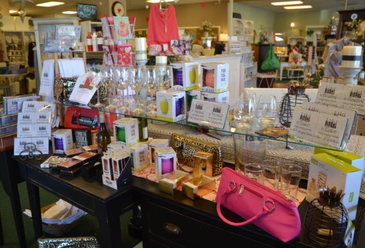 The Lorraine K. Boutique, located in the Clock Tower Square, features a variety of gift items, including wine glasses, coasters, and even wine purses, as seen here. (Bee Photo, Silber)