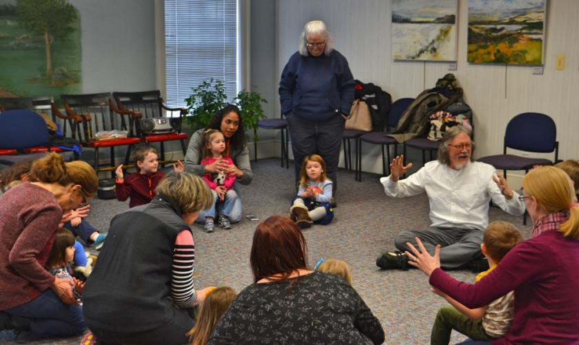 Music educator Brad Peterson, pictured right, leads children in the C.H. Booth Library's Music Dynamics class on February 9 through a variety of games, songs, dances, and nursery rhymes. (Bee Photo, Silber)