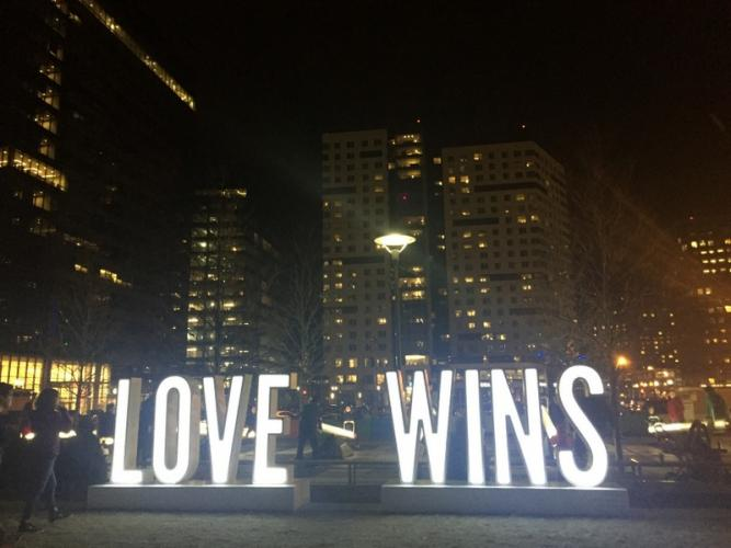 """A """"Love Wins"""" sign shines on February 24 as part of the Impulse public art installation at Seaport Common in Boston.  (Bee Photo, Silber)"""