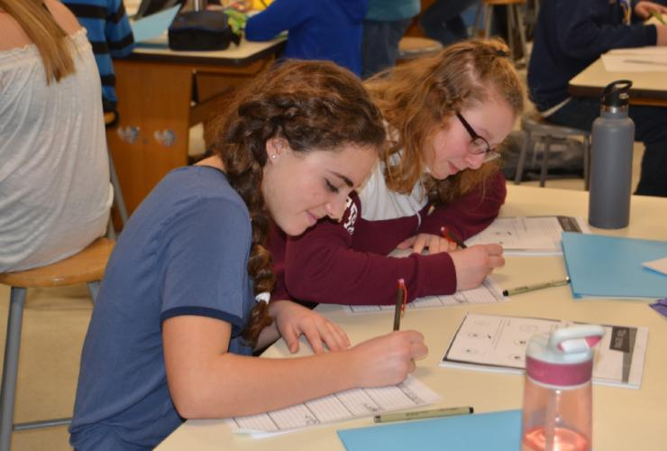 Pictured from left are seventh grade art enrichment students Eva Barricelli and Allie Kost working on their comic titled The Sneaky Samurai Take On The World during the Newtown Middle School's Day of Art on February 16. (Bee Photo, Silber)