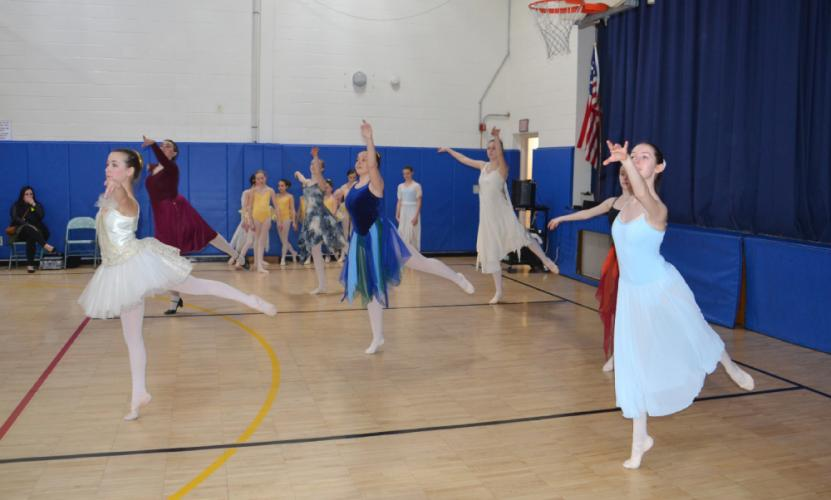 Pictured from left are Newtown Centre of Classical Ballet & Voice dancers Fallyn Kirlin as Saturn, Arline Almeter as Jupiter, Taegan Smith as Mercury, Kylee Raiano as Neptune, Julia Finegan as Venus, Annie Fowler as Mars, and Chelsea Fowler as…