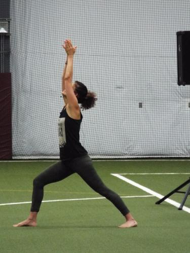 Hala Khouri taught a variety of yoga poses, including Warrior One, as seen here, for the first half of the Newtown Yoga Festival's morning community class. (Bee Photo, Silber)