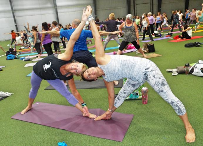 During Tao Porchon-Lynch's community class at the Newtown Yoga Festival, Sharon Poarch and Toni Nuzzolo expertly displayed a partner yoga pose. (Bee Photo, Silber)