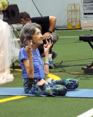 """World-renowned yoga instructor Tao Porchon-Lynch, who is """"99 years young,"""" taught the second portion of the Newtown Yoga Festival's afternoon community class on Saturday, August 26. (Bee Photo, Silber)"""