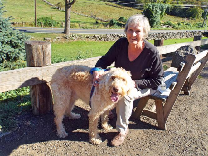Ginny Wolcott and her dog Luther visited Ferris Acres Creamery on Monday, October 2. (Bee Photo, Silber)