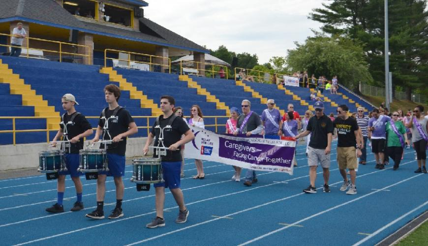 Caregivers of those affected by cancer were honored during the second official lap at Relay for Life of Newtown after the opening ceremony on June 16. (Bee Photo, Silber)