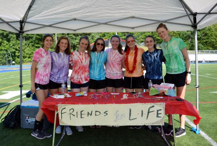 Pictured from left are Savannah Duffy, Caroline Malin, Faith O'Hara, Amanda Conrad, Abby Tainter-Gilbert, Caroline DePinto, Julia Klein, and Grainne Flanagan of Relay For Life's team Friends For Life at Newtown High School on June 16. (Bee Photo, Silber)