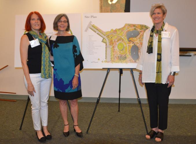 Pictured from left are Julia McFadden of Svigals + Partners, Joan MacLeod of Damon Farber Landscape Architects, and Teri Kwant of RSP Dreambox, standing before their proposed Sandy Hook permanent memorial design, labeled SH240 by the commission. …