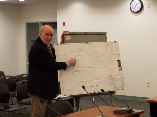 George Benson of the Land Use Agency visited the Sandy Hook Permanent Memorial Commission meeting on Thursday, March 9, to provide members with the official draft of the map of the SAC Field property. (Bee Photo, Silber)