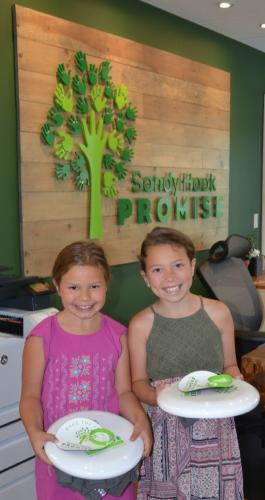 Sisters Abigail DellaVentura, 8, left, and Grace DellaVentura, 9½, of Roots4Relief, visited the Sandy Hook Promise house in Newtown on July 5. They each received thank you items for their generous contribution to help end gun violence.  (Bee…