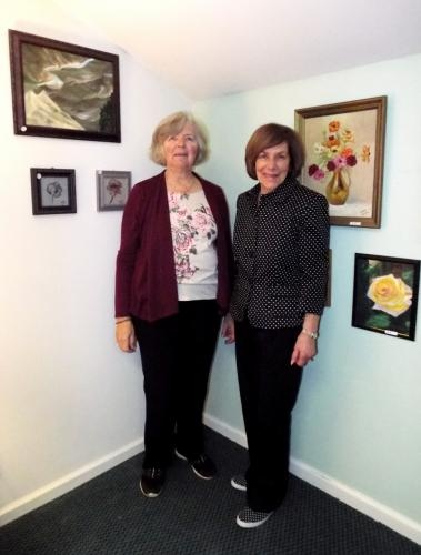 """Pictured are local artists Mary Goebel, left, and Joyce Goldin at the opening reception for their art exhibit """"Every Picture Has A Story"""" at the Newtown Senior Center on Tuesday, November 7. (Bee Photo, Silber)"""