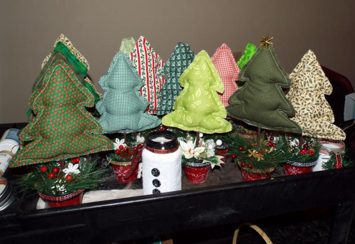 A new item that members of the Newtown Senior Center have designed for this year's Holiday Bazaar are miniature holiday trees. They will be available in a variety of colors and designs. (Bee Photo, Silber)
