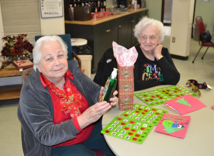 Luella Dwyer and Terry Curry were both winners at the Senior Center's Holiday Bingo on December 20. (Bee Photo, Silber)