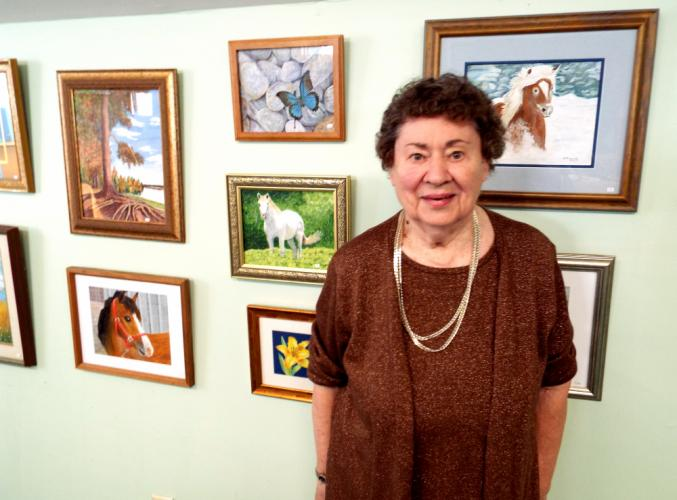 """Nunnawauk Meadows resident Shirley Kopnicky hosted an art gallery reception at Newtown Senior Center on September 12, when she spoke about her """"One Woman Show."""" (Bee Photo, Silber)"""