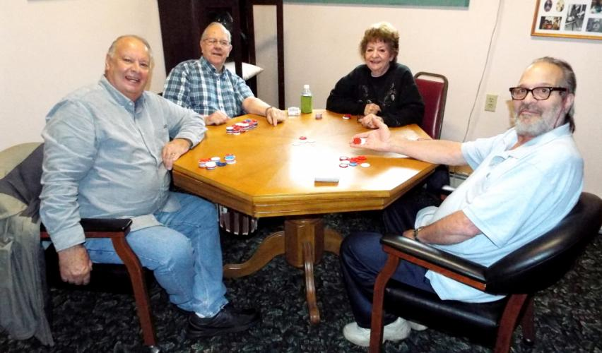 On Tuesday, November 7, the Newtown Senior Center's poker group gathered to play at 1 pm. Pictured from left are poker players Vito Bevilacqua, Robert Sharpe, Marilyn Chernin, and John Spremullo. (Bee Photo, Silber)