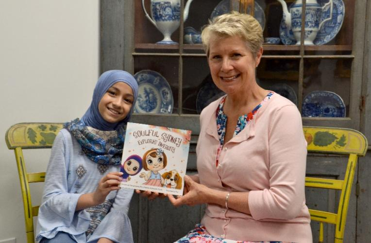 Mariam Azeez of Newtown and Terry Murphy of Southbury hold their new children's book, Soulful Sydney Explores Diversity, that was released in April on Amazon. The two will be joined on Sunday by Ms Murphy's sister, Deborah Clarke of Maryland, for a…