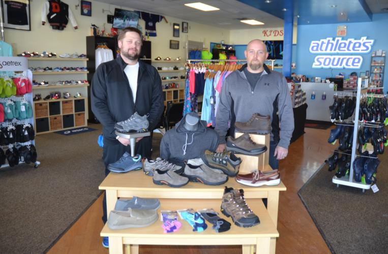 Erik Tonner, left, and Brian Maciel are two of the four business partners who opened The Athlete's Source last April in the location of a former New Balance franchise at 83 Stony Hill Road (next to Big Y). The store carries a variety of winter shoes…