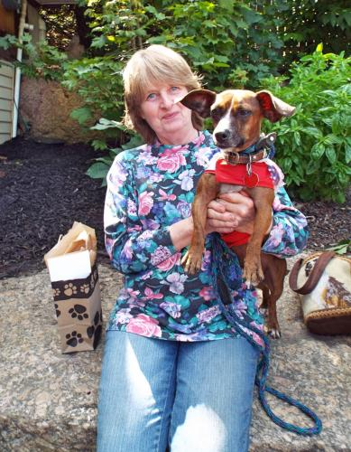 Barbara Gaydosh holds her 4-year-old rescue dog Kisso after his triumphant win of Best Kisser at Yappy Hour on Saturday, August 26. (Bee Photo, Silber)