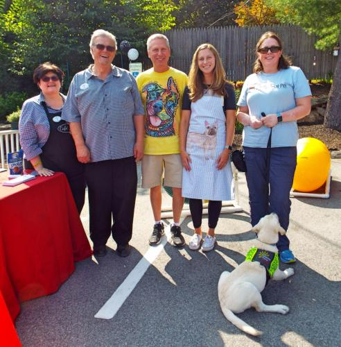 Pictured from left are Yappy Hour hosts Marie and Bob Schlump of Cafe Xpresso, Tom Novak and his daughter Casey Mecca of Your Healthy Pet, and Abby Hill of The Exceptional Pet, with dog Archie. (Bee Photo, Silber)