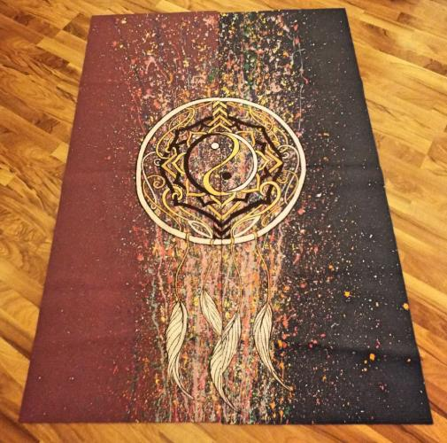 Each of the yoga mats have been skillfully hand painted and depict a variety of creative designs. Pictured are two individual yoga mats that when placed side by side create one larger image. (Bee Photo, Silber)