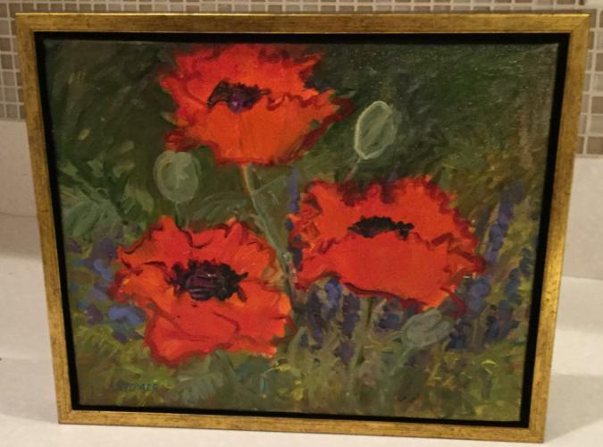 """:""""Red Poppies"""" by Ann Kramer is one of the colorful images filling Avance Day Spa during a special holidays exhibition on view until early January. A brunch reception is planned for Sunday, November 12."""