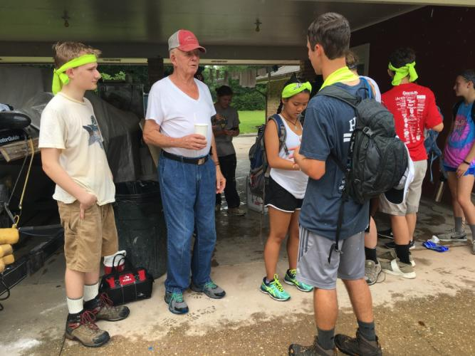 Ben's Lighthouse volunteers listen to flood stories from Louis Harris of Denham Springs, La., one of the locations where the Newtown group offered assistance last month.  (Rebecca Cosgrove photo)