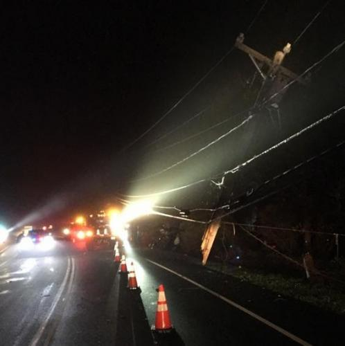 Looking east on Berkshire Road, the base of the snapped pole hit early Friday morning can be seen dangling by its utility wires.  (Sandy Hook Volunteer Fire & Rescue photo)