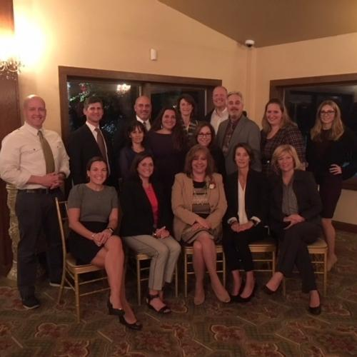Newtown Public Schools staff and Board of Education members surround Interim Superintendent of Schools Dr Lorrie Rodrigue, front center, at the Connecticut Association of Schools (CAS) annual celebration of educational leadership, held on October 26…