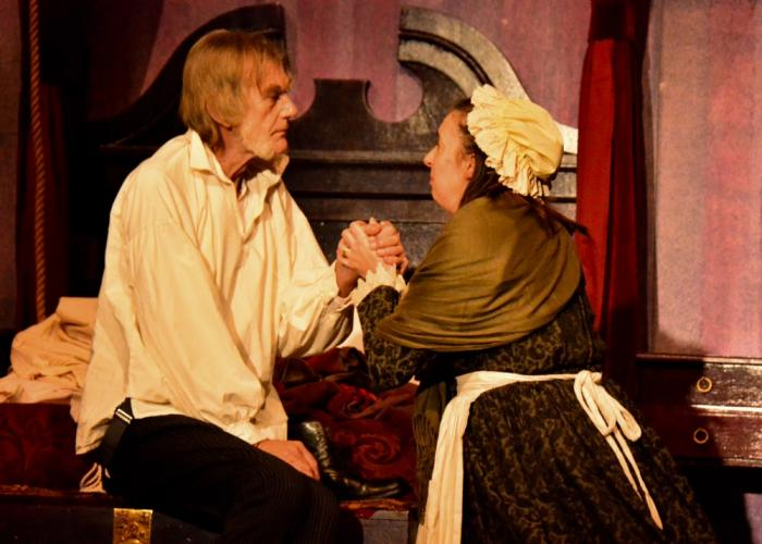 Graeme Malcolm (Scrooge) confesses his newfound appreciation for Christmas to his shocked housekeeper Cara Hughes (Mrs Dilber).