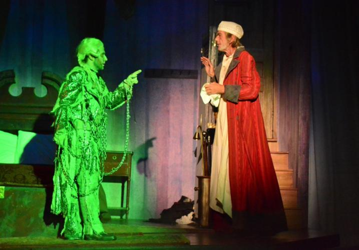 The ghost of Jacob Marley (Joseph DeVellis) was just the first of numerous spectral visitors dropping in on Ebenezer Scrooge (Graeme Malcolm ) in the 2017 NewArts cast of A Christmas Carol.  (Sandra Doscher photos)