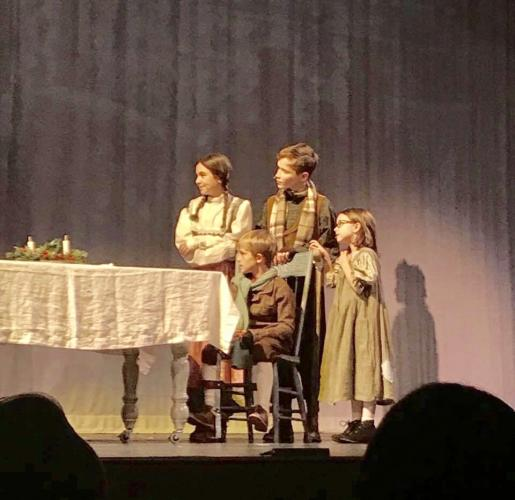Martha (Ava Baroody), Tiny Tim (George Mecca), Peter (Jimmy Hunter), Belinda (Ellie Lemieux) in a scene from the 2017 NewArts production of A Christmas Carol. These actors were members of the Mistletoe cast of the production, which closed a very…