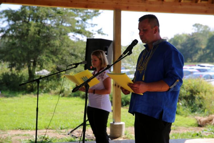 Roman and Olena Stanislavskyy of the Blessed Virgin Mary Ukrainian Catholic Church of Bridgeport announced performing groups at the festival. (Bee Photo, Hallabeck)