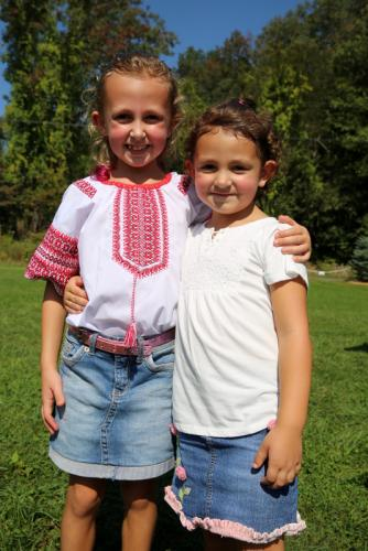 Sisters Victoria, left, and Gabriella Grychak of Monroe were among those attending the 42nd Annual Ukrainian Festival at Paproski's Castle Hill Farm last weekend. (Bee Photo, Hallabeck)