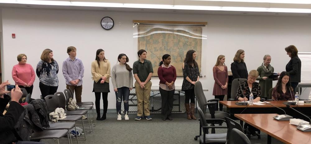 Board of Education Chair Michelle Embree Ku, far right, hands certificates to members of the Newtown High School Best Buddies Club at her board's meeting on February 6. Standing from left are club co-advisors Mimi Riccio and Jill Gonski, and…