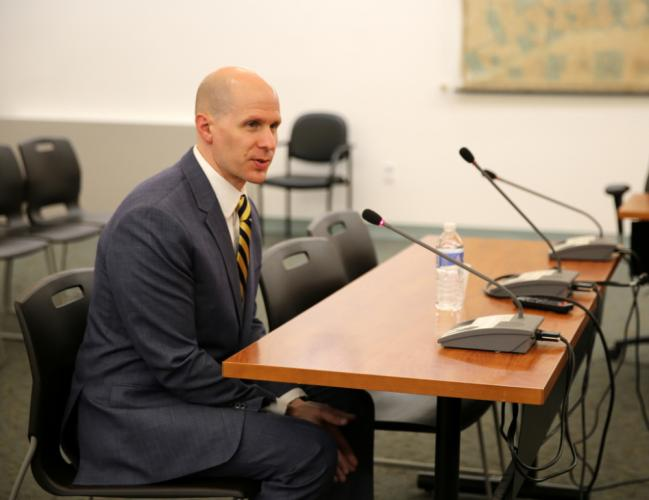 Chris Siano speaks at the June 25 Board of Education special meeting after being voted to serve on Newtown High School's administrative team, starting July 2.  (Bee Photo, Hallabeck)