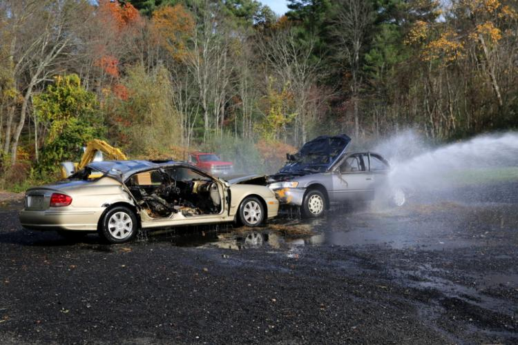 Two cars were used in a live burn demonstration at the Botsford Fire Rescue open house. Visitors also had the chance to douse the cars with water after the live burn took place. (Bee Photo, Hallabeck)